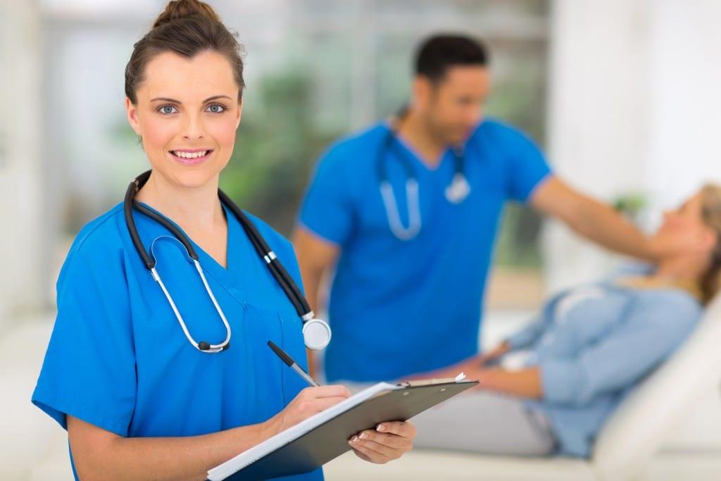 portrait of gorgeous nurse holding clipboard