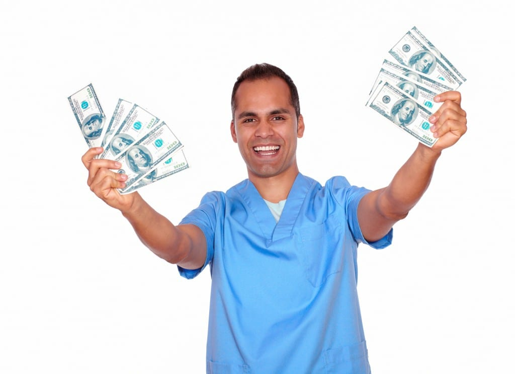 Cheerful Guy In Nurse Uniform Holding Cash Money